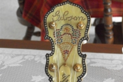 9136-3_gibson_mastertone_banjo_tb-florentine_peghead