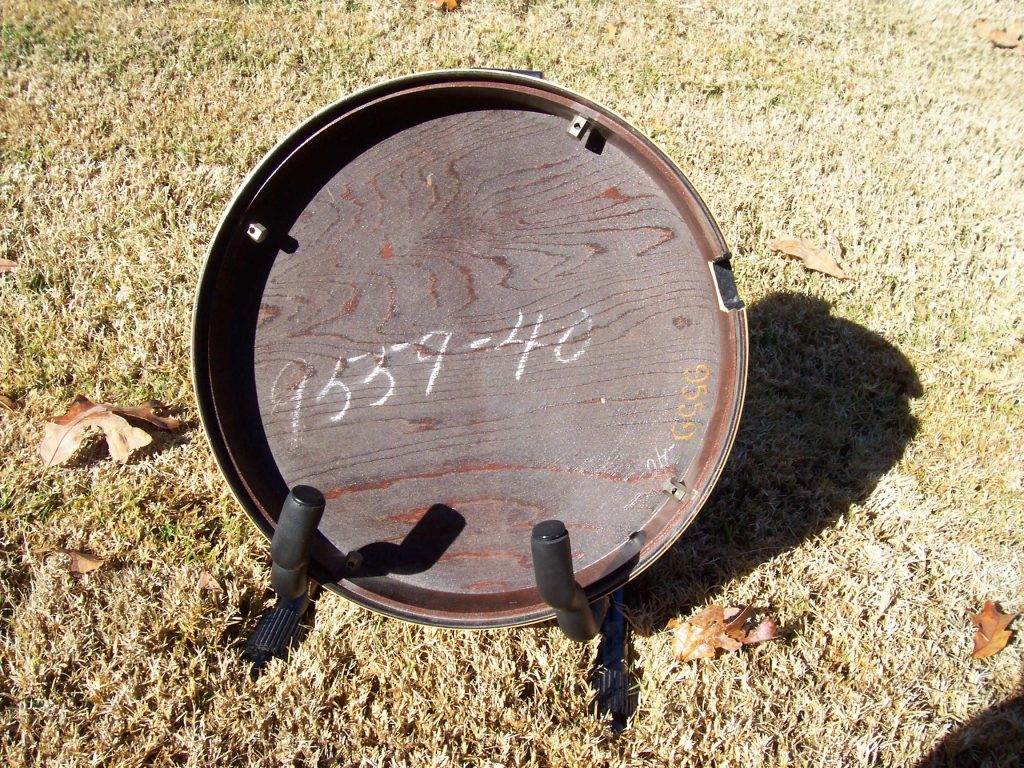 The factory order number will be written inside the wooden back, or resonator, of a Gibson banjo.